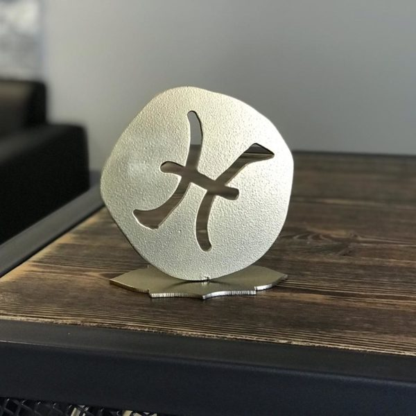 Знак зодиака из металла